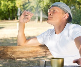 Man puffing on a cannabis or marijuana cigarette