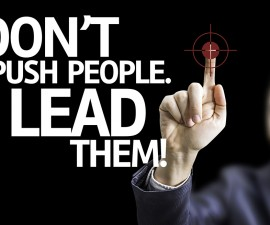 Business man pointing: Don't Push People, Lead Them!